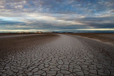 The Colorado River disappears into a vast mud-caked plain south of Yuma, Arizona, never reaching its outlet at the Sea of Cortez. Upstream diversion, primarily for agriculture, has diminished its flow.