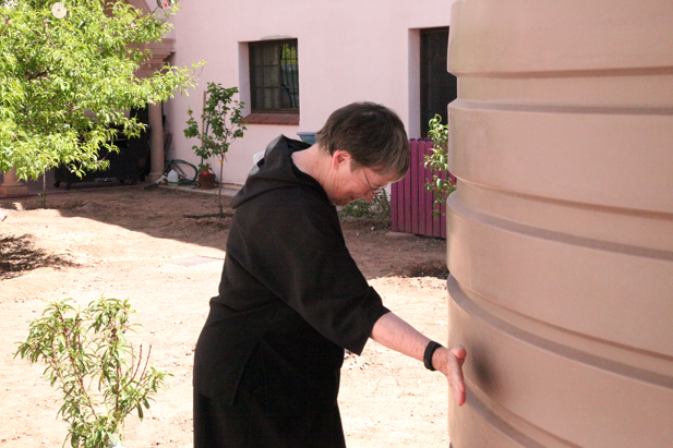 Sister Joan Ridley checks the water level in a cistern at the Benedictine Monastery.