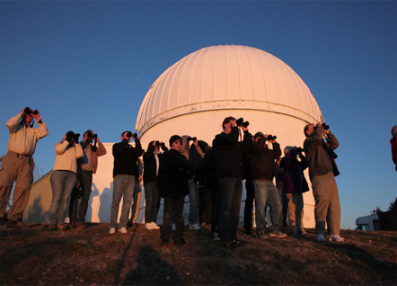 """Astronomy tourists"" look westward from the Mt. Lemmon Sky Center above Tucson. (Photo by Mark Duggan)"