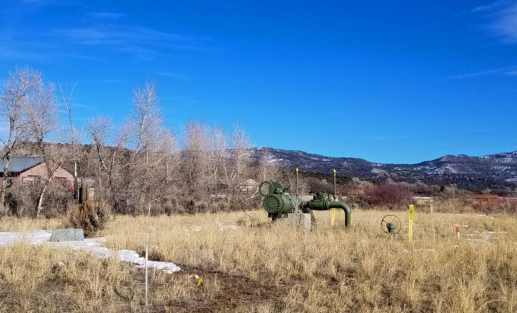 Natural gas equipment in a field near Bayfield, Colorado
