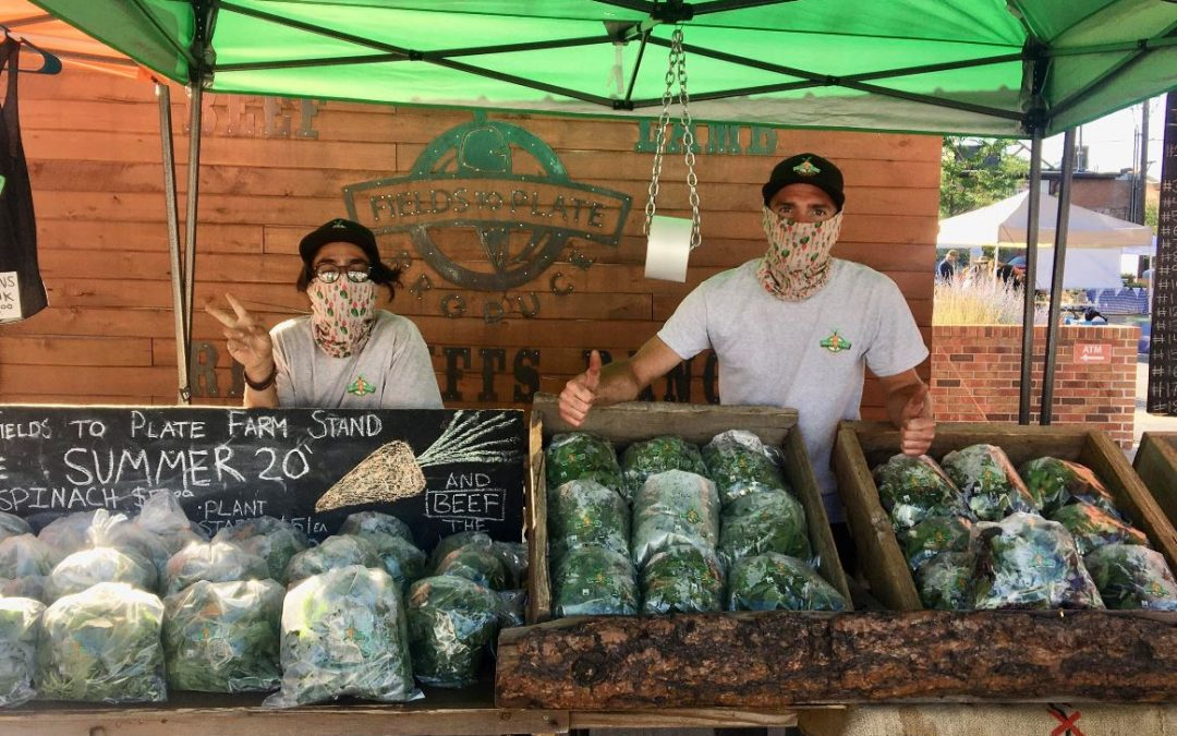 farmers market vendors in face masks